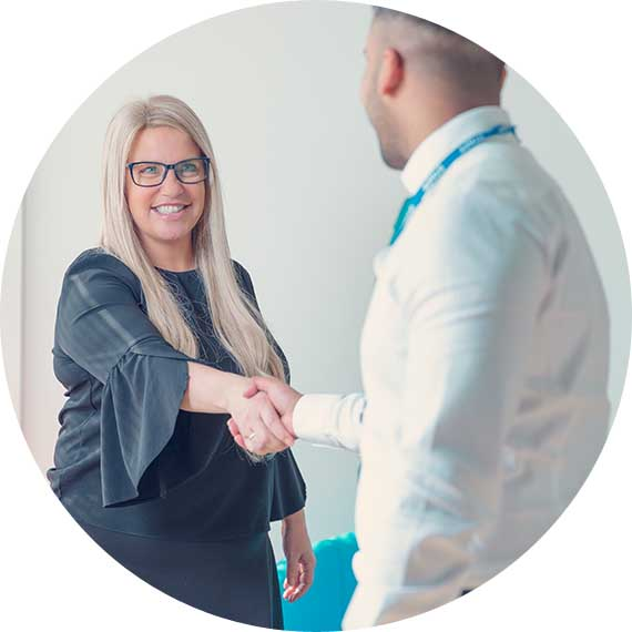 Storetec employee shaking hands with a client